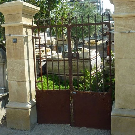 Old gate made of wrought iron - an iron gate superbly colored by rust.