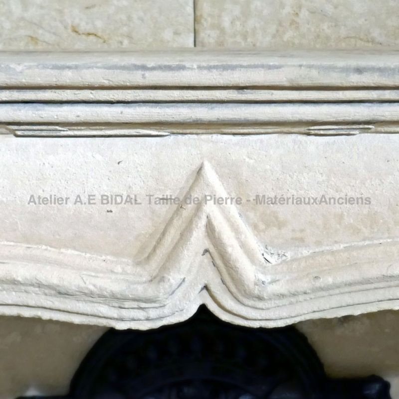Details of very fine moldings carved by hand on our Louis XV white stone fireplace.