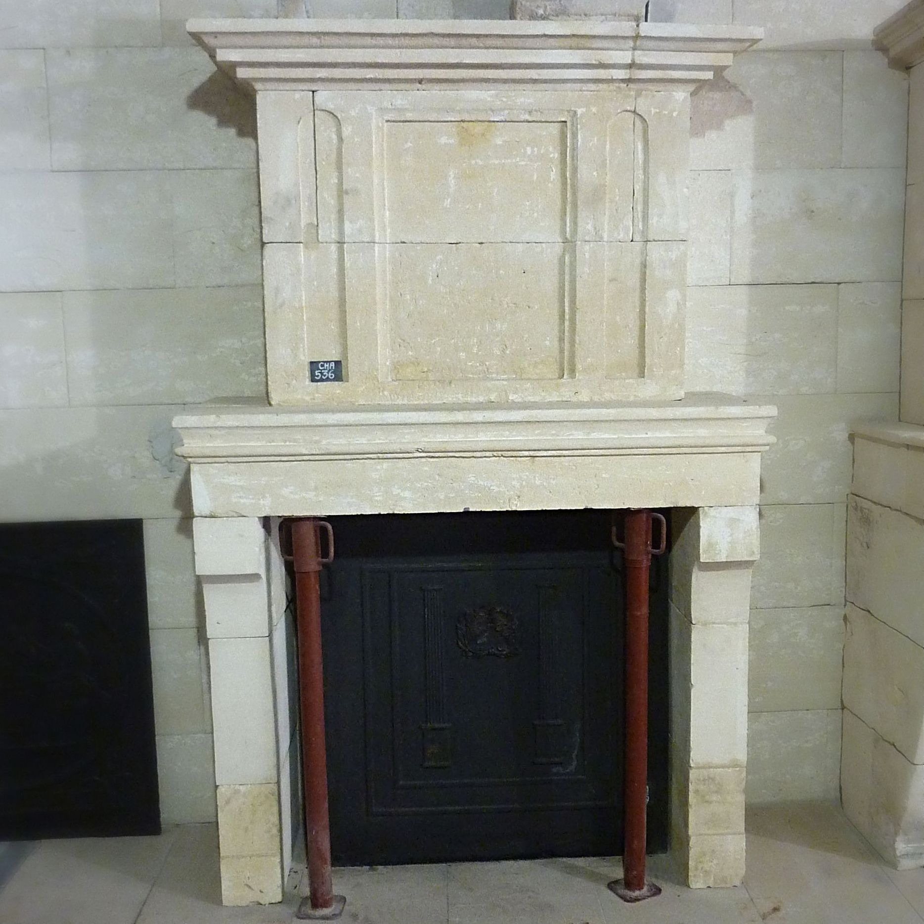Antique Louis 16 style stone fireplace - A French fireplace with trumeau from the 18th century.