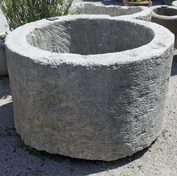 Large round trough in patinated hard stone - Solid stone trough as an outdoor ornament.