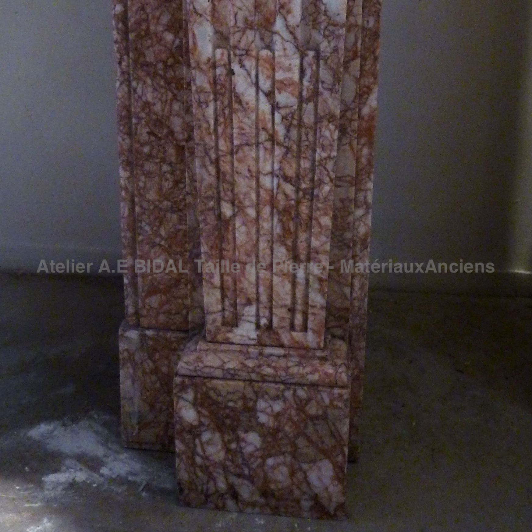 Decoration of the jamb of our pink marble fireplace with white stipes - Louis 16 fireplace.