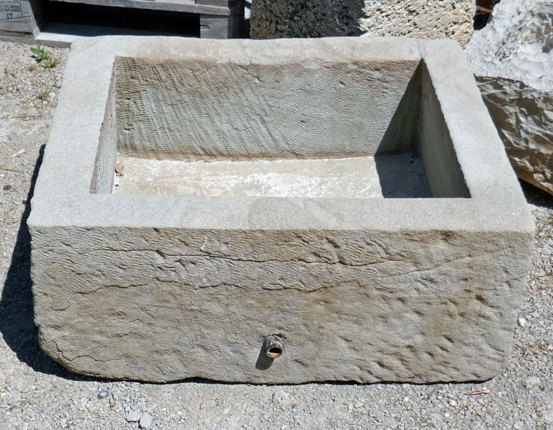 Sale of antique stone troughs at Alain BIDAL Antique Materials in Provence.