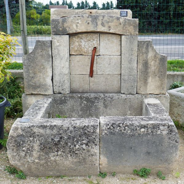 Outdoor fountain with rectangular basin - a nice garden fountain in stone.