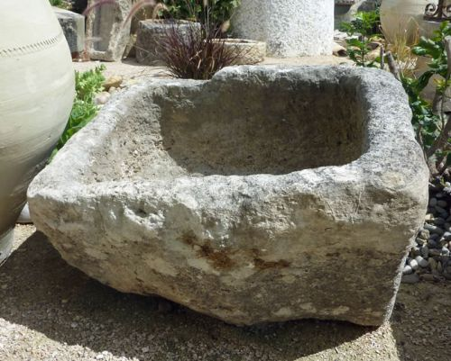 old stone basin - made by stonemason
