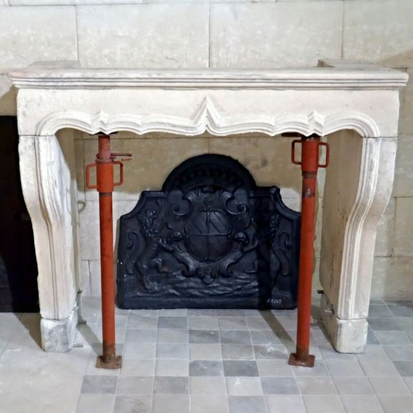Large Louis XV stone fireplace for sale among a wide choice of antique mantels at Alain BIDAL.
