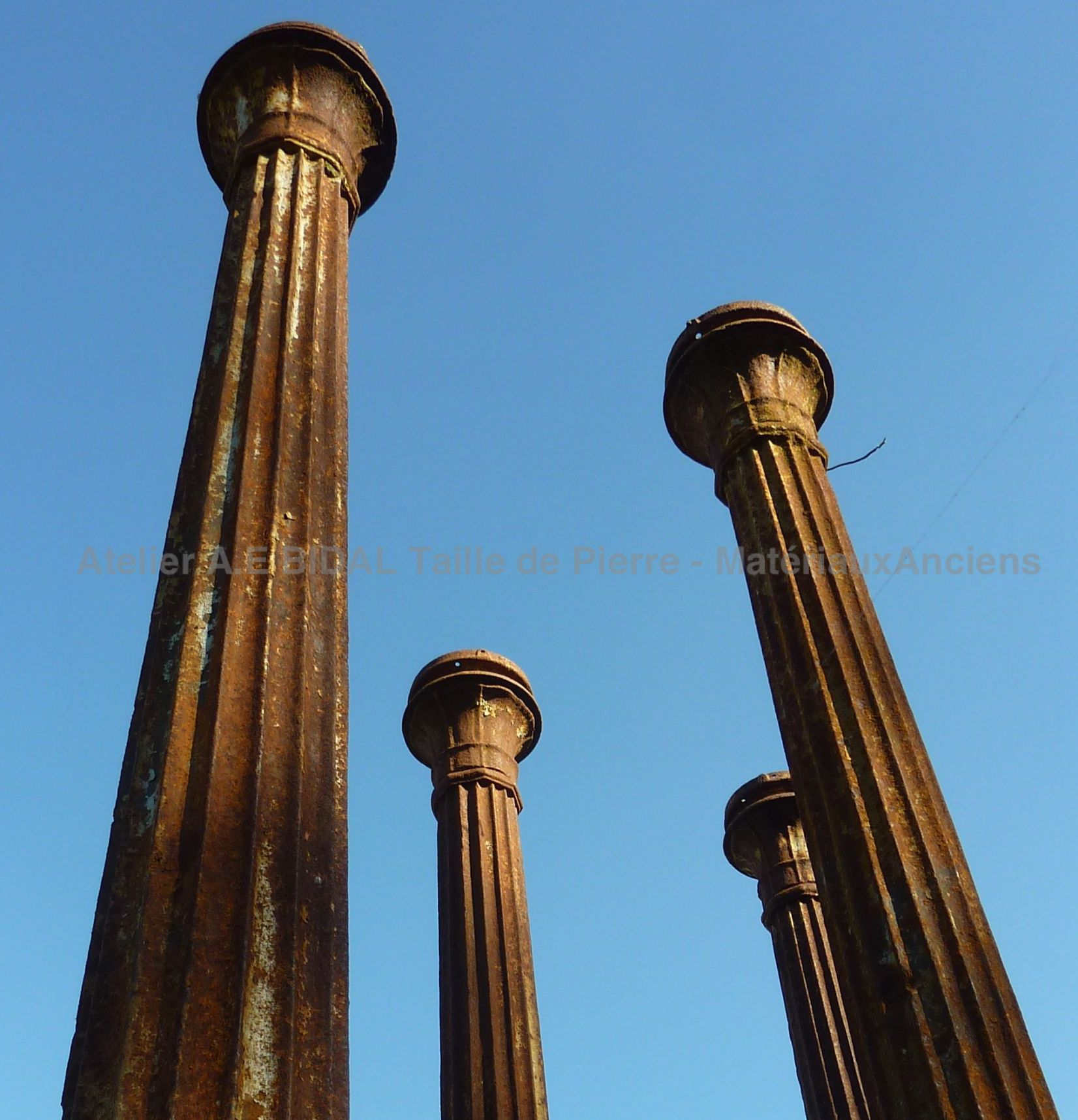 Top of an old pillar - Doric column made of cast iron (5 examples).