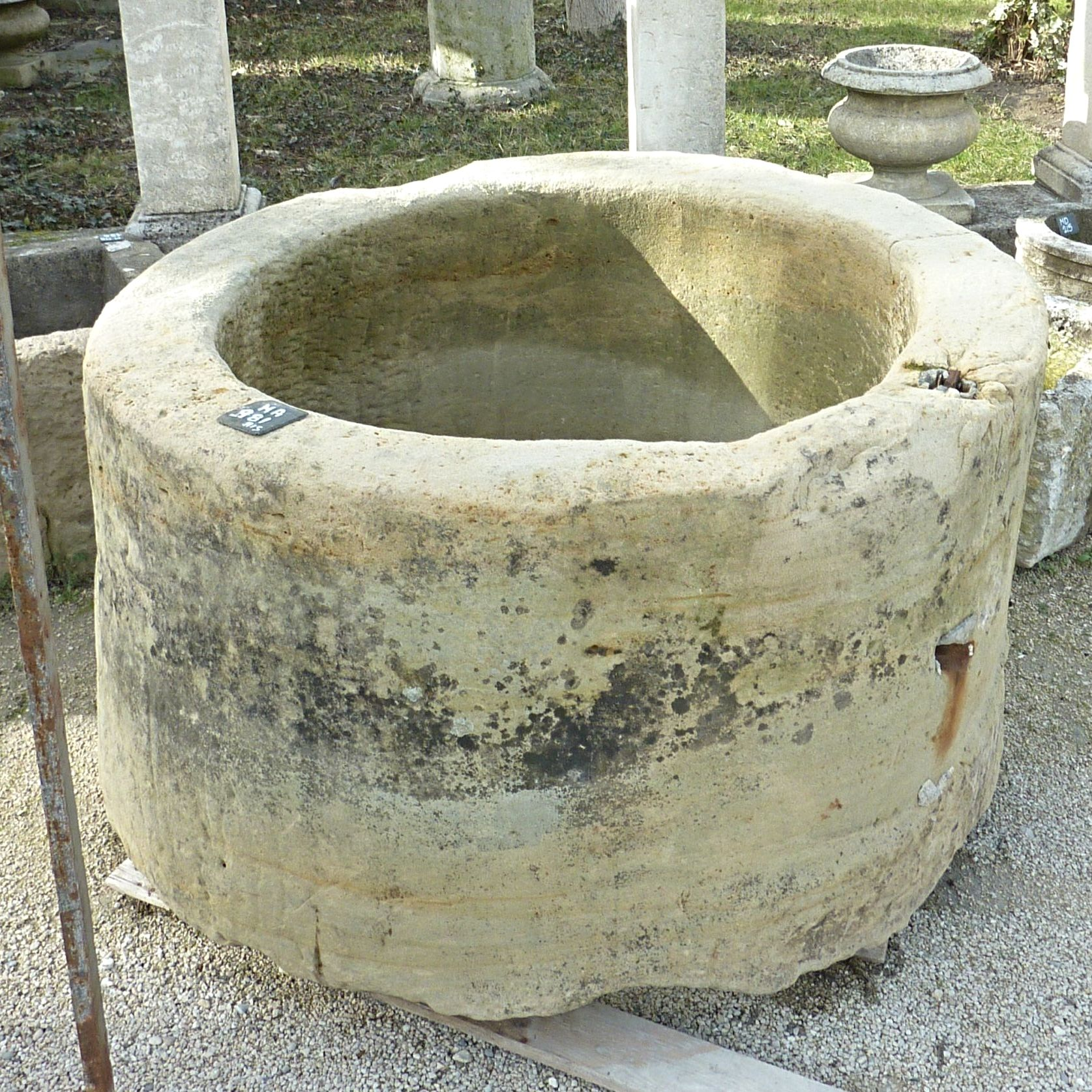 Beautiful old stone well that could become a beautiful stone planter.