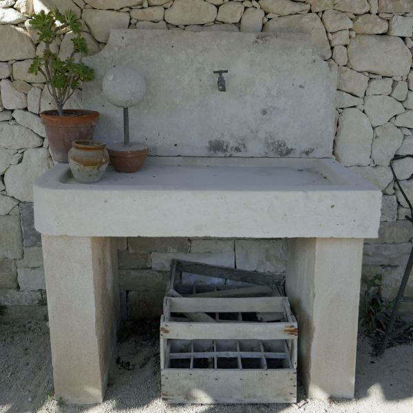Beautiful summer kitchen with natural stone sink.