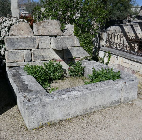 Beautiful wall fountain | Garden fountain with a rectangular basin and a large stone pediment.
