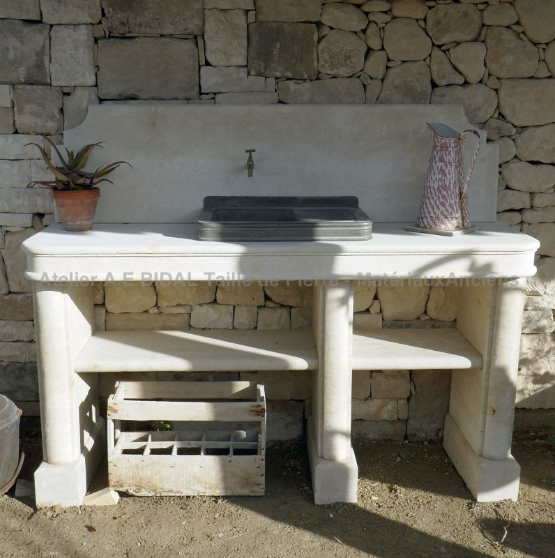 Summer kitchen made of natural stone with pewter sink by Atelier Alain BIDAL