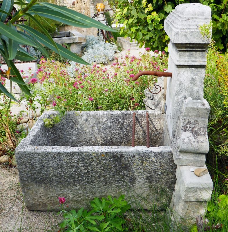 Garden fountain in stone : terrace fountain or garden fountain with trough.