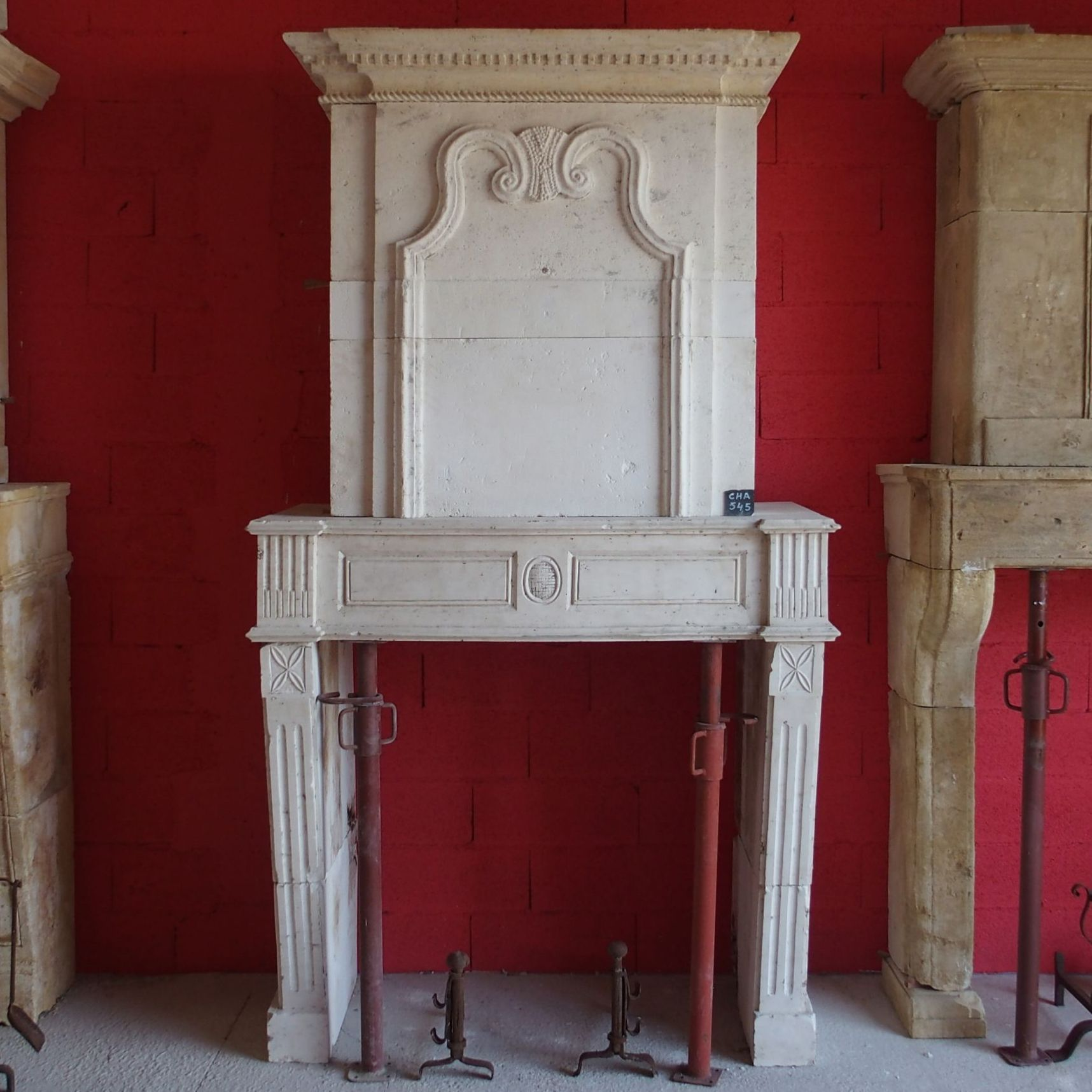 Very beautiful stone fireplace that is very decorated - Louis XV fireplace with overmantle.
