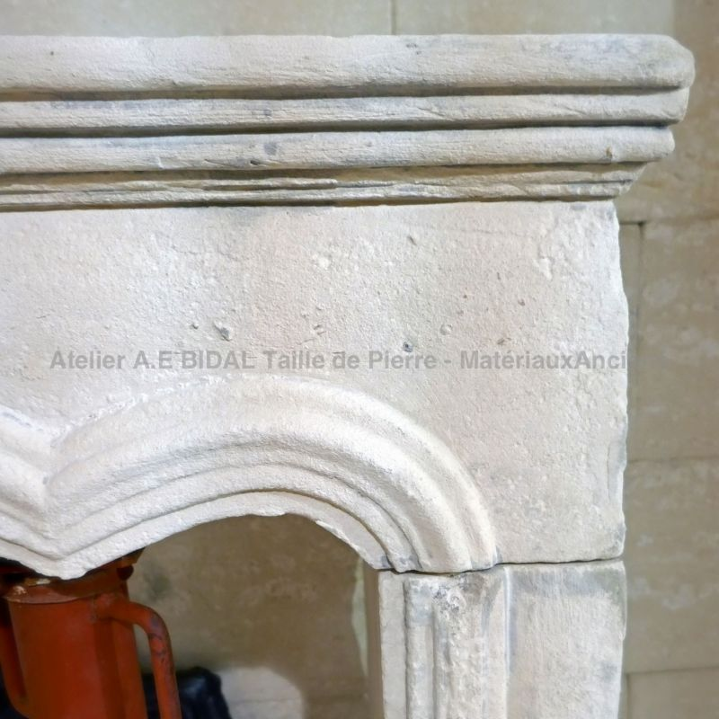 Antique Louis XV style stone fireplace for sale at Alain Bidal Antique Materials.