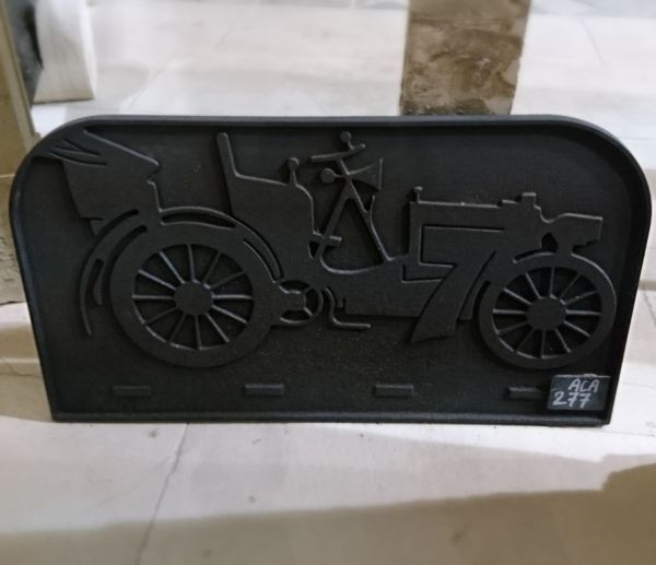 Beautiful cast iron fireback representing an old automobile - our old fireplace accessories.