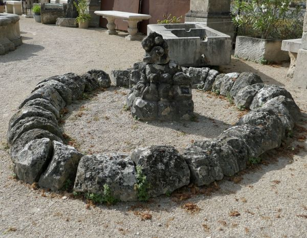 Low central fountain - an outdoor fountain with shallow and rustic stone bassin.