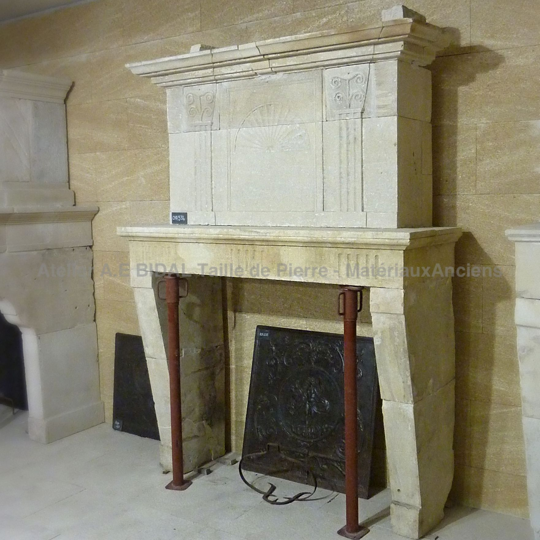 Antique Louis 16 stone fireplace - A beautiful fireplace with a nice stone trumeau.