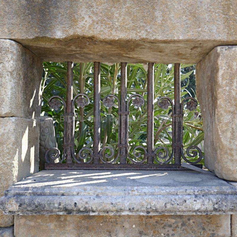 Detail of the window frame on our large garden fountain in stone and metal - Alain Bidal Antique Materials in Provence