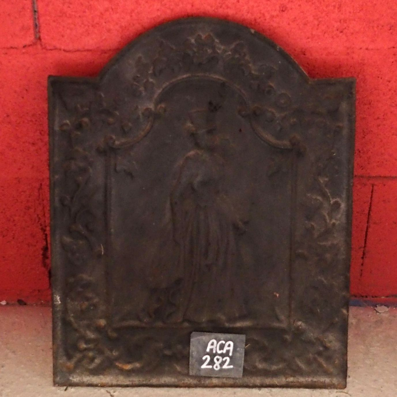 Cast iron fireback representing a woman as well as plants - our old fireplace accessories.