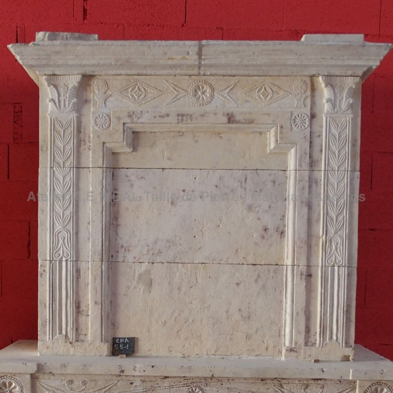 Louis XVI fireplace - traditional antique fireplace made of natural stone.