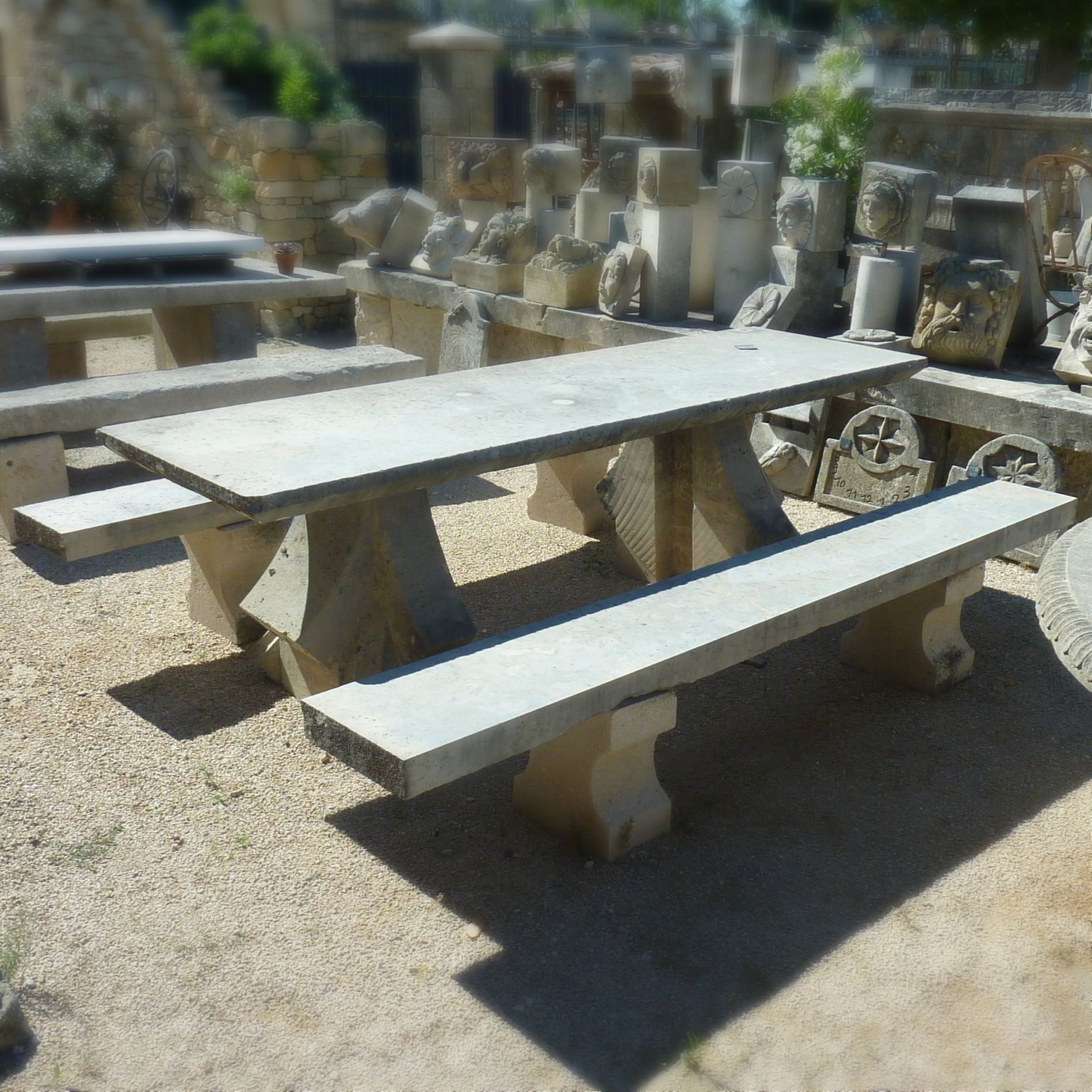 Antique and sustainable garden furniture exposed on our park of pieces of furniture made of old materials near Avignon.