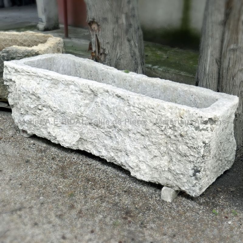 Long stone planter for sale amongst a wide choice of stone troughs at Alain BIDAL.