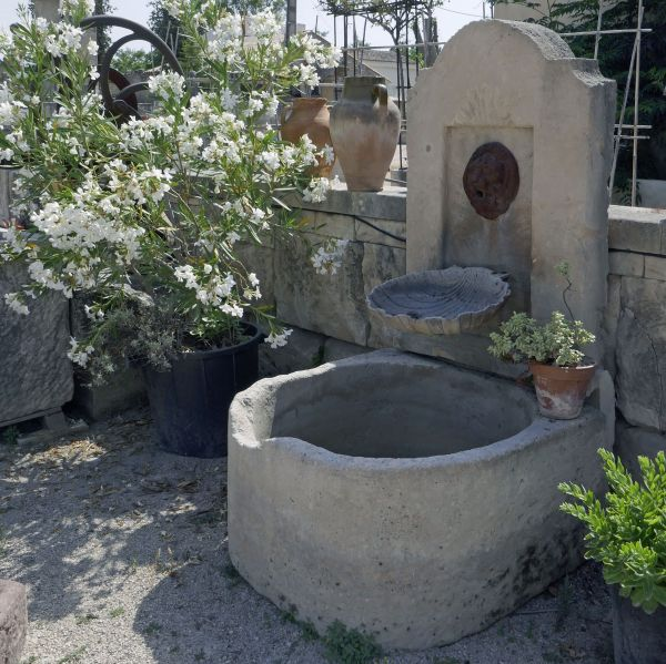 Stone and iron wall fountain | Small garden fountain perfect for decorating a small space with elegance and refinement.
