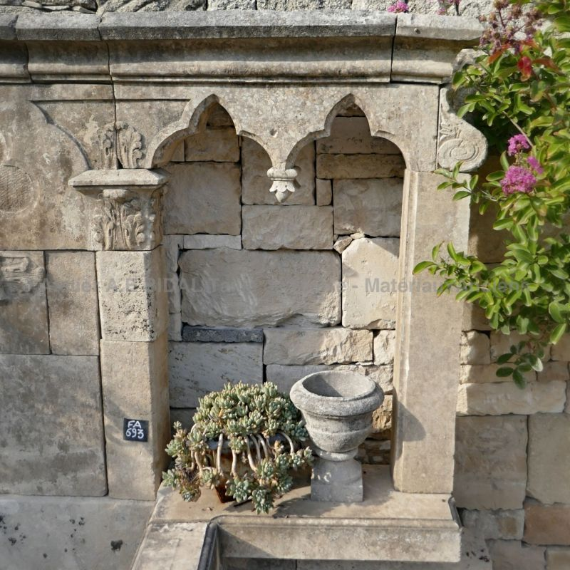 Fountain made of antique stones with a Gothic style inspiration