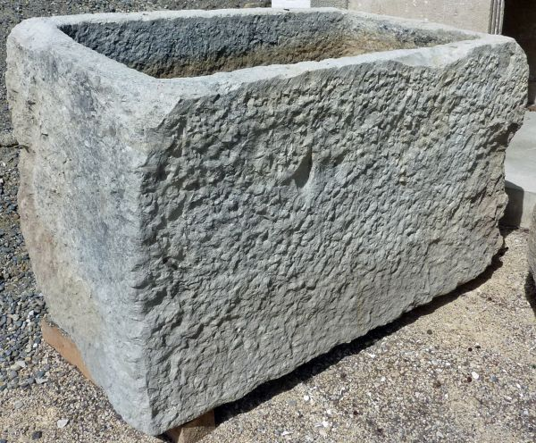 Large antique trough in stone on sale exclusively at Alain Bidal Antique Materials in Provence.