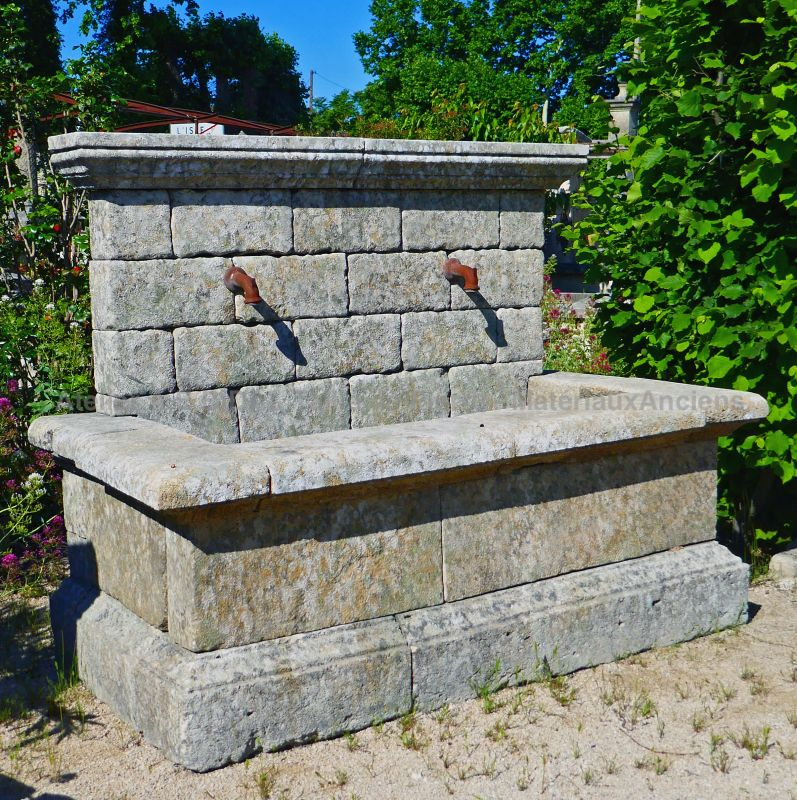 Stone wall fountain : antique outdoor fountain in stone by Alain BIDAL Antique Materials in Provence