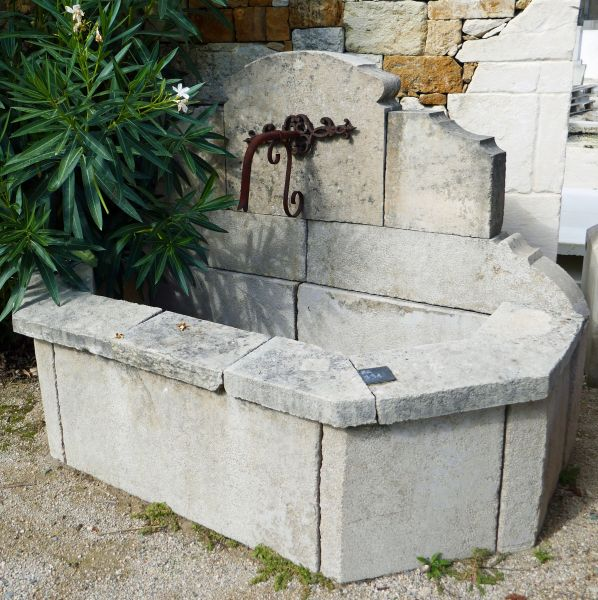 Small garden wall fountain in old stone by Alain Bidal Antique Materials in Provence.