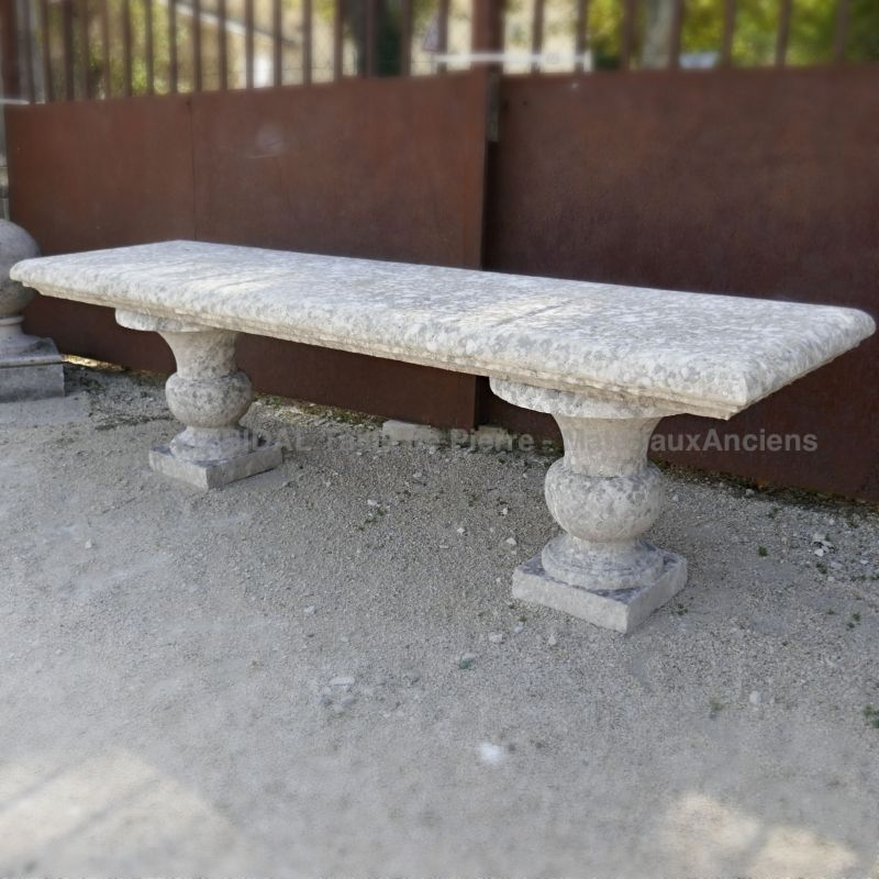 Antique garden furniture in stone by Atelier Alain Bidal in Provence.