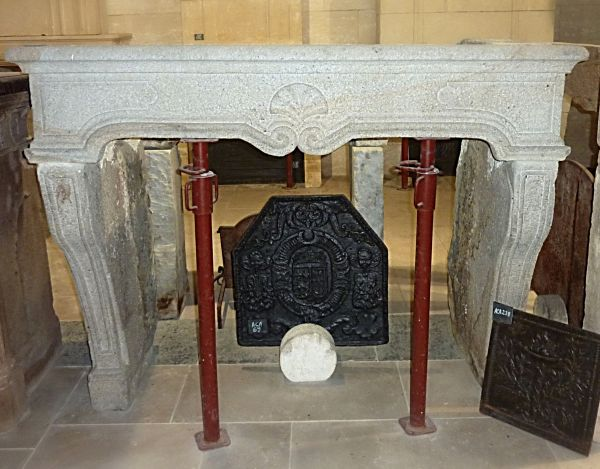 Ancient granite fireplace- An antique Louis 15 fireplace in stone.