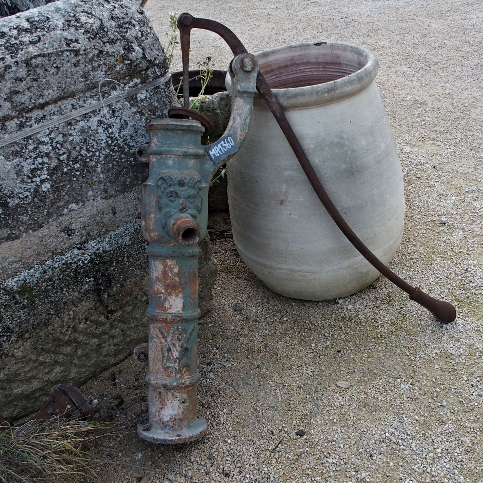 Superb manual pump - a manual pump with green patina.