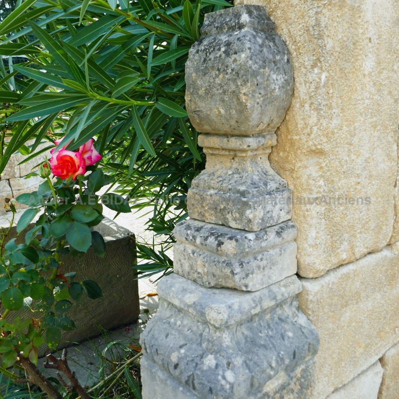Detail of one of the sculpted side stone on our large garden fountain in stone and metal - Alain Bidal Antique Materials in Provence