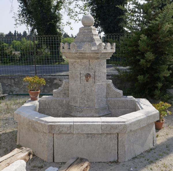 Large garden fountain with basin, column and hand-sculpted capital for sale at Alain BIDAL Antique Materials - Provence.