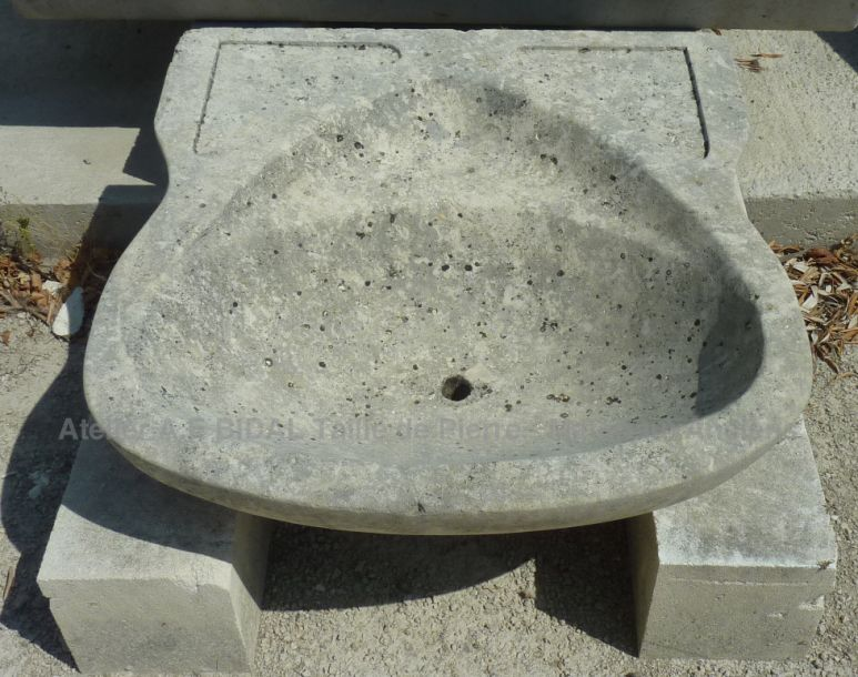 Beautiful old sink, a stone sink - stone washbasin for bathroom.