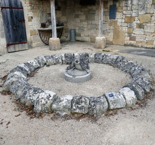 Old round basin in rustic natural stones by  - Alain Bidal Antique Materials in Provence