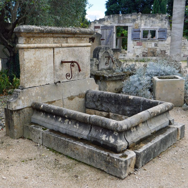 Antique fountain in stone by Alain BIDAL Antique Materials in Provence.