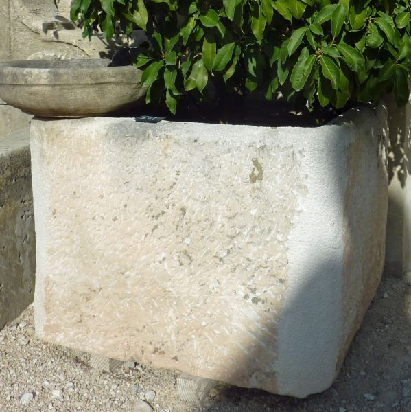 White antique Provence-style stone trough.