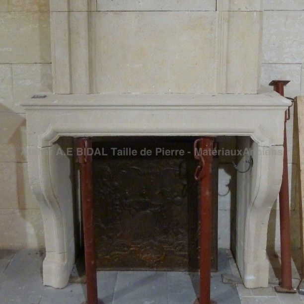 Fireplace with overmantle - an old stone fireplace.