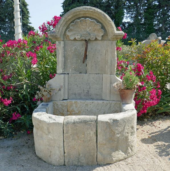 Regence stone fountain for outdoor landscaping | Fountain of creation by Alain Bidal in Provence.