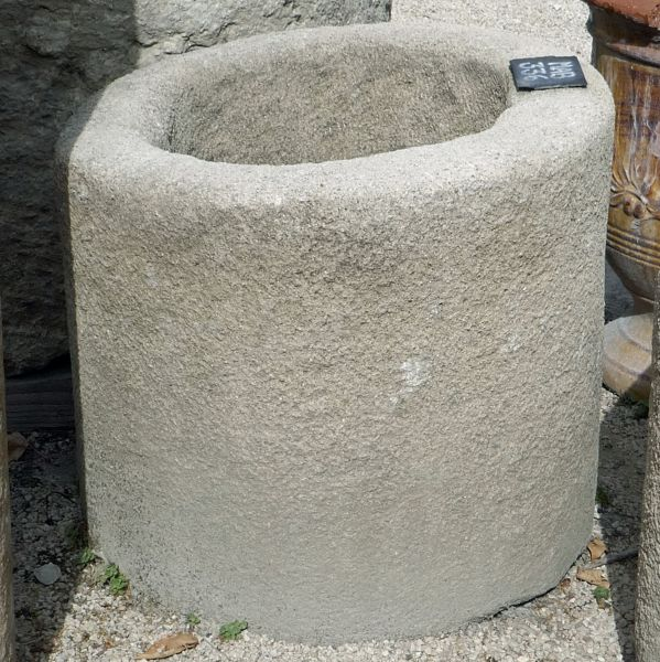 Beautiful circular trough made of authentic stone -  flowerpot.