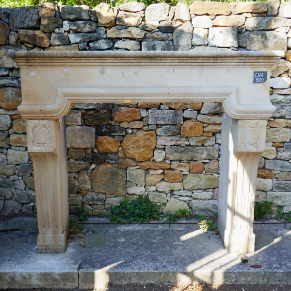 Louis 14 fireplace carved in limestone - light colored decorative mantle.
