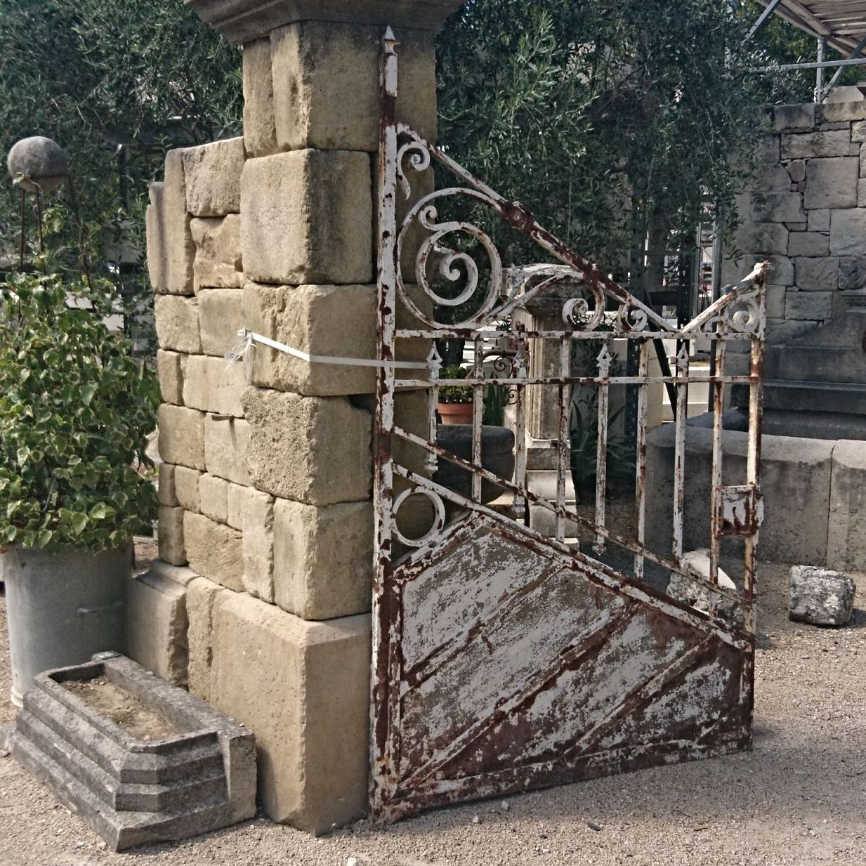 Wrought iron gate in a white color - Nice old house gate.