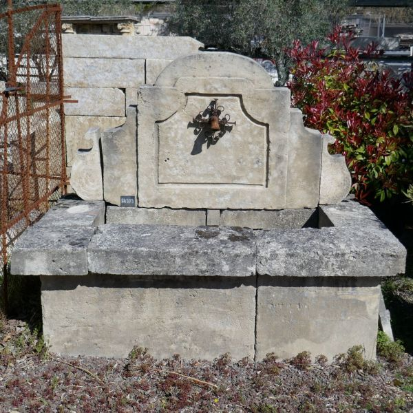 Small fountain for garden decoration | Wall fountain of Provence in wrought iron and natural stone signed Alain Bidal.