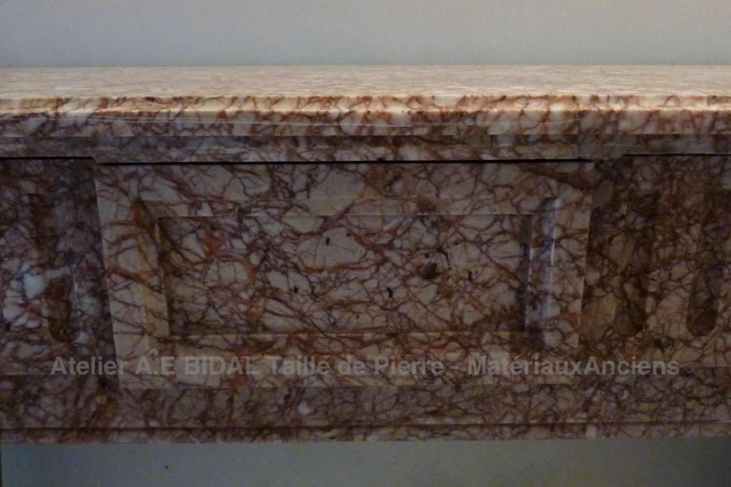 Traditional fireplace - pink marble fireplace in Louis 16 style.