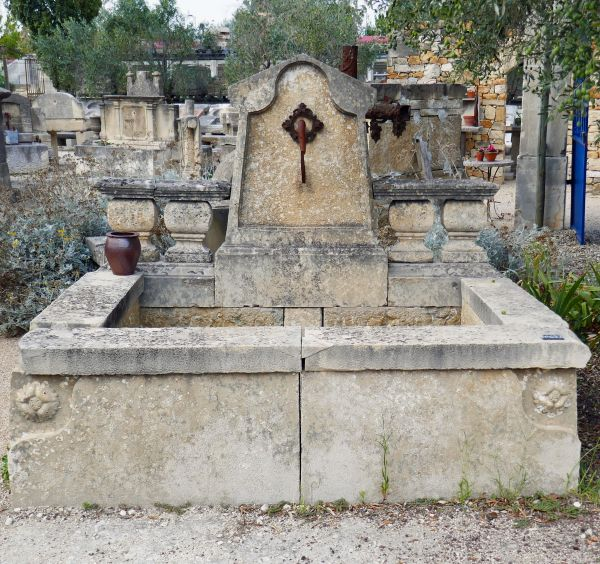 Large fountain, a type of stone fountain, a garden fountain with a molded pediment and a deep basin.