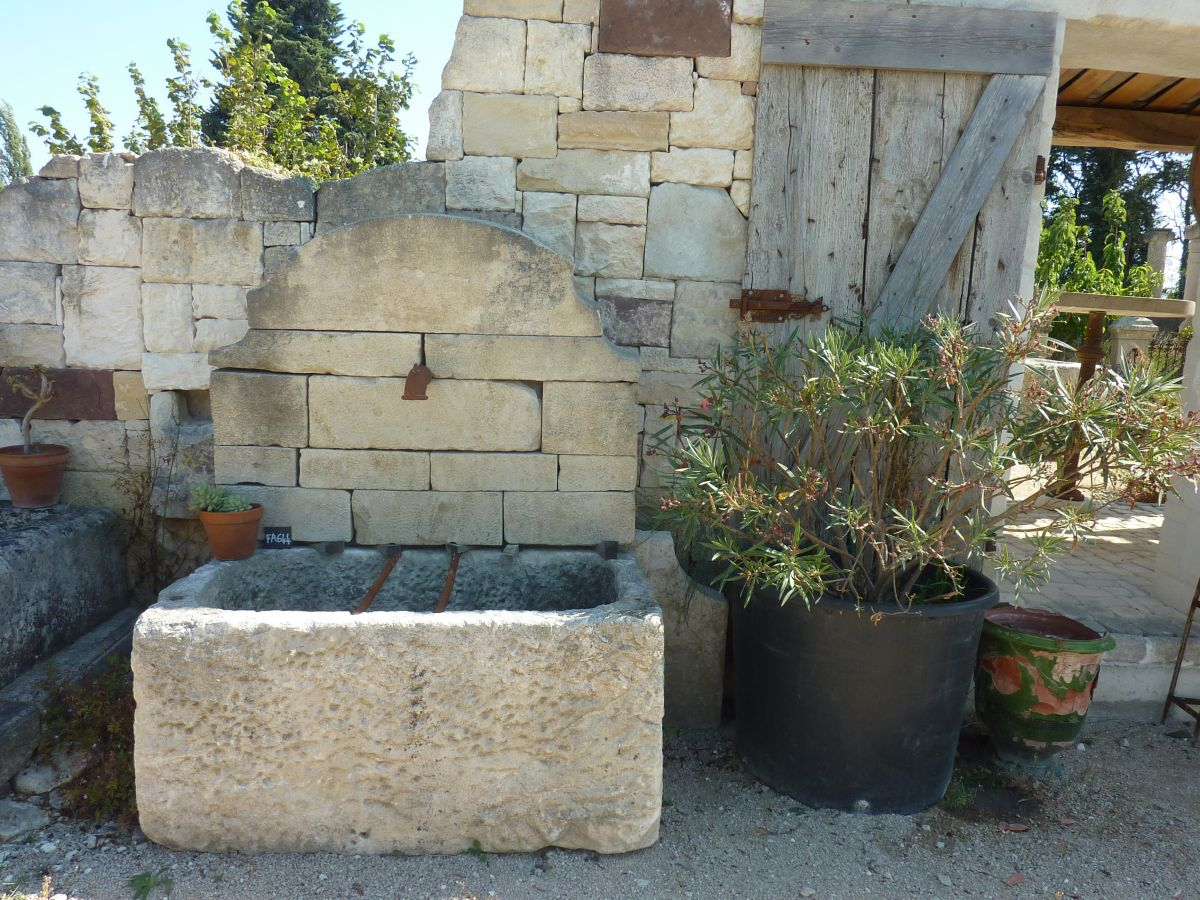 Wall fountains with monolithic troughs