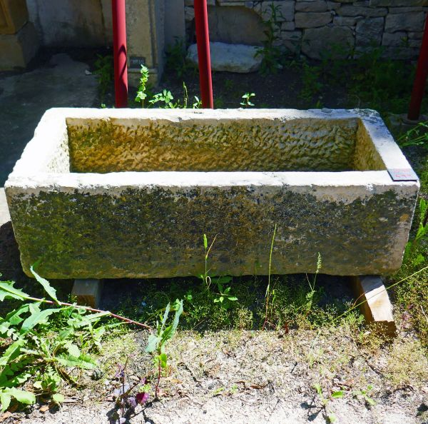 Long old trough in stone on sale at Alain Bidal Antique Materials in Provence