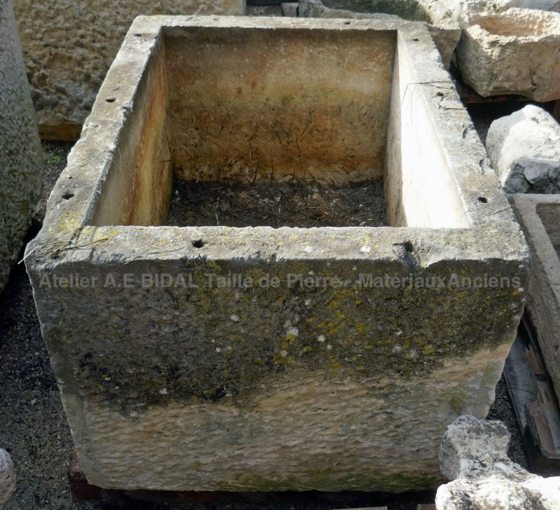 Antique trough in old patinated stone for sale at Alain Bidal Antique Materials in Provence